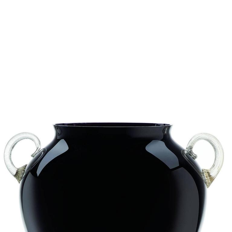 This magnificent black Murano glass vase is shaped as an Amphora and this Classic form is reinvented with a unique color combination of striking black and white. Exquisite details in white Murano glass adorn the base and create the two precious