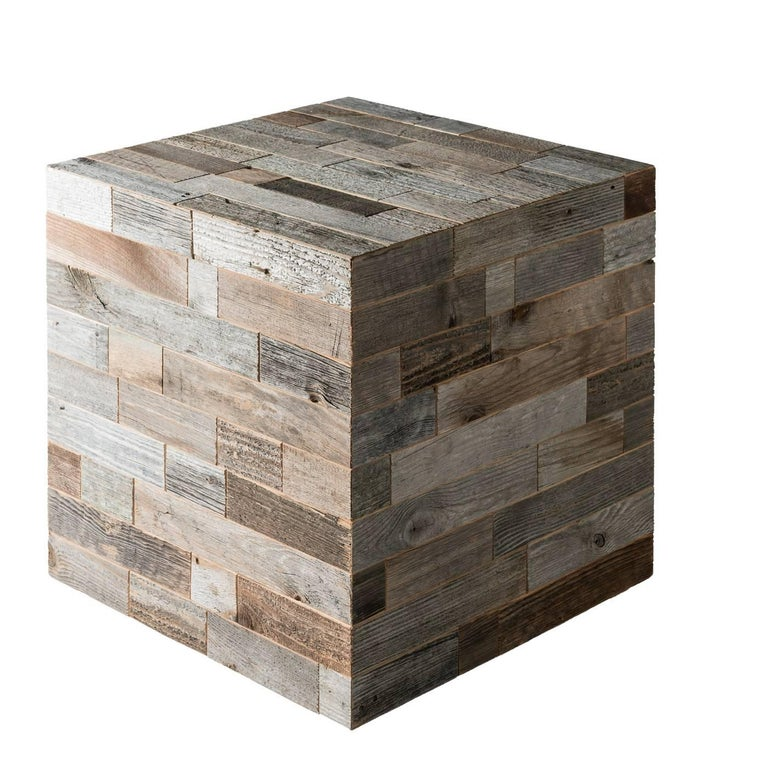 This contemporary design performs a dual function: decorative and functional. Its cubic shape is made of strips of wood recovered from the beams and planks of old barns that are restored by hand and have a different color resulting from exposure to