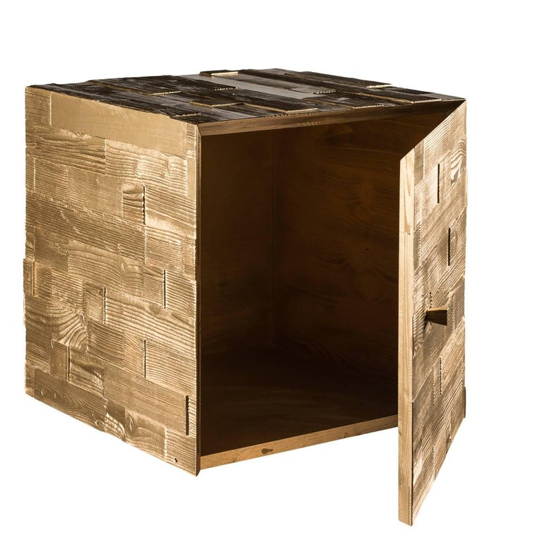 This contemporary design performs a dual function: decorative and functional. The cube is made of strips of fir, recovered and restored by hand, overlapped to form a basket weave pattern. The door has a small wooden knob and hidden latch. This