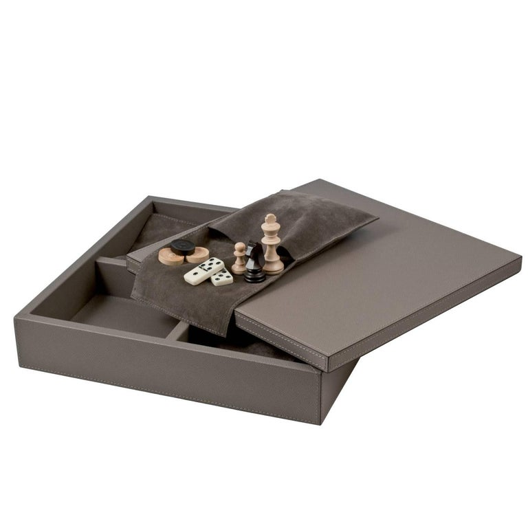 This charming case is a striking box that can be displayed anywhere in the house, while it hides inside three sets of games: chess, draughts, and domino. A wonderful addition to any living room, this box is made in wood with a leather cover that can