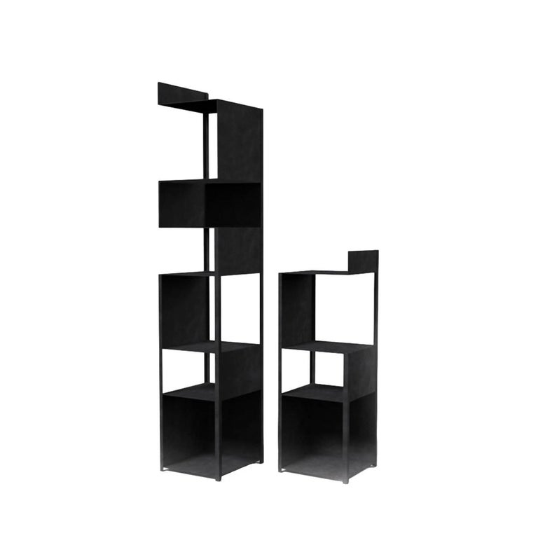 A minimalist and sophisticated bookcase, this column is made of press-folded sheets of steel of 1.5 mm width, while the angles are reinforced with 20 x 20 mm elements. The entire structure is painted using epoxy resins in an elegant black shade with