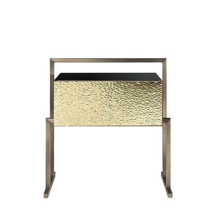 Designed by Giovanni Luca Ferreri, this exclusive nightstand is part of the Transition collection, featuring innovative pieces with simple, geometric lines that combine luxury materials with traditional handcrafting techniques. The tubular brass