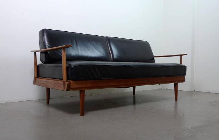 Walter knoll teak sofa bed with black leather cushions for Sofa bed germany