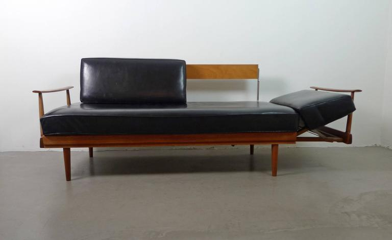 walter knoll teak sofa bed with black leather cushions. Black Bedroom Furniture Sets. Home Design Ideas