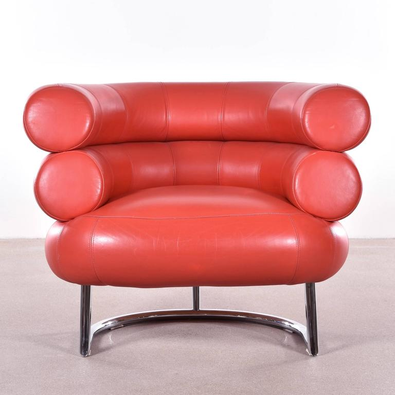 Famous and comfortable club chair in red leather. Signed with impressed manufacturer's mark and date.