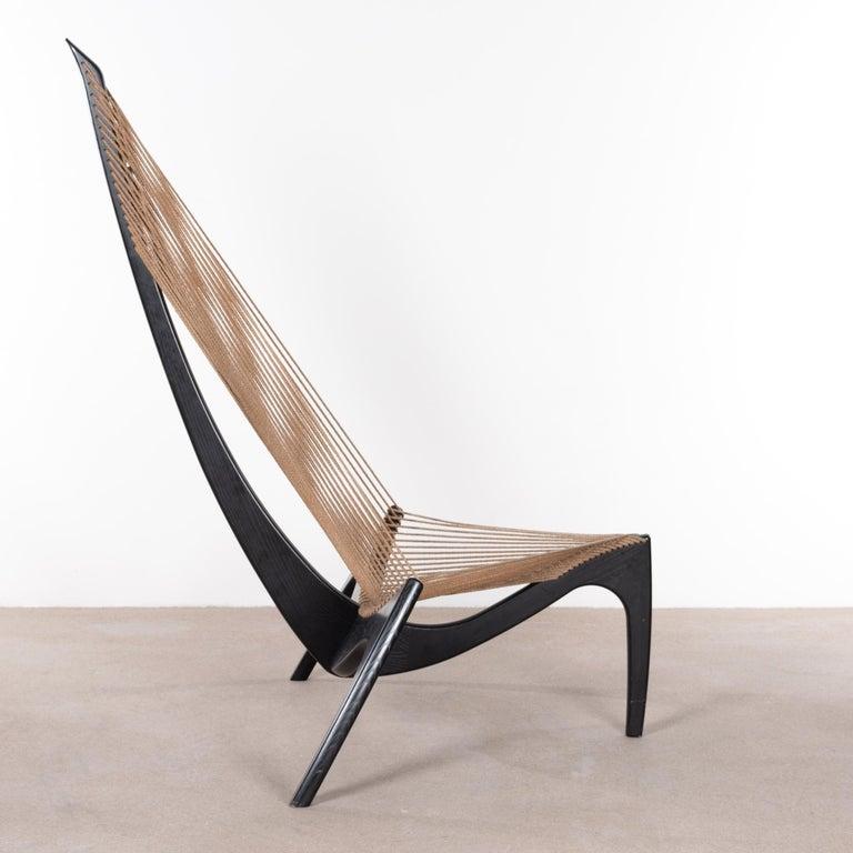 Elegant and surprisingly well-sitting Jørgen Høvelskov Harp chair for Jørgen Christensens, Denmark. 40th Anniversary edition in black ebonized ash finish all in original condition. Light traces of use mainly on the wooden frame.