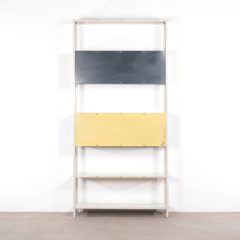 Rare modular bookcase or room divider designed by Friso Kramer in 1953 for 'De Bijenkorf' and produced by Asmeta.  Good original condition with traces of use.