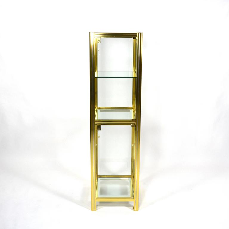 Beautiful Italian showcase made of brass with chrome details. This vitrine has two doors that can be locked separate. In excellent condition but the lower glass shelve is replaced by a new one (this glass shelve is not shown in the
