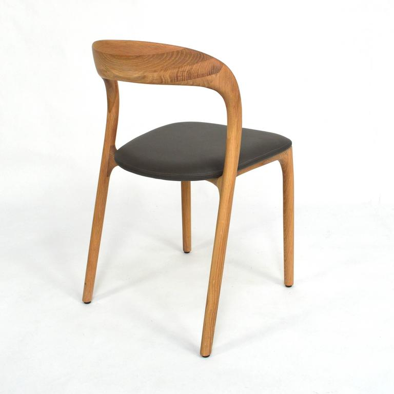 artisan 39 neva light 39 dining chairs in oak and leather for