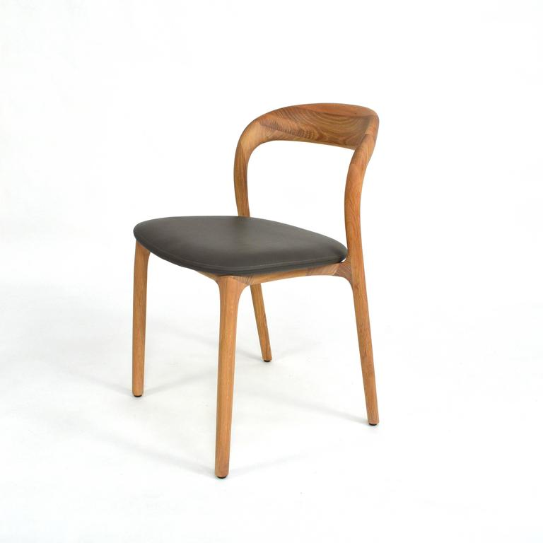artisan neva light dining chairs in oak and leather for