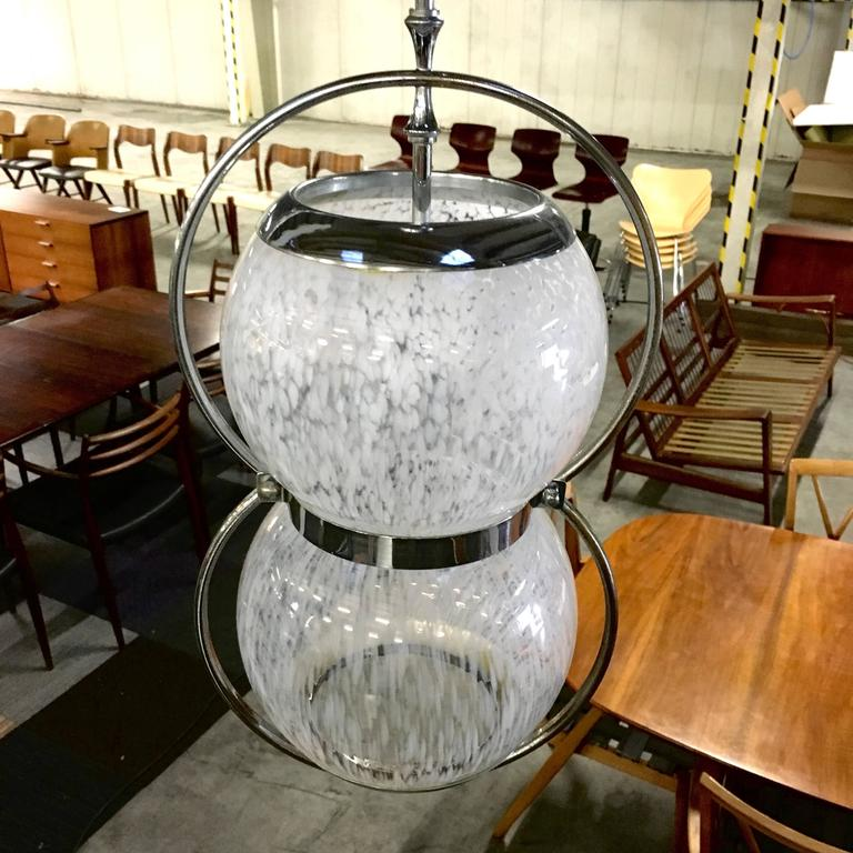 Beautiful pair of Italian blown Murano glass pendant lamps with chrome-plated metal. It may be Murano or in the style of but that they are very rare is certain. The glass is semi-see through and has milky white striped spots. Both the glass and the