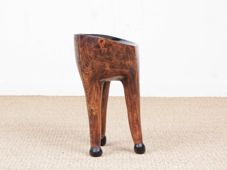 Unique piece of art: Three legs stool in acacia by French sculptor Yvon. Top is made of burned and polished pine. Frame is calaminated and waxed steel. Signed under the top.