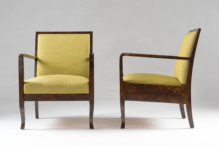 A pair of high quality Art Deco lounge chairs made of birch, probably produced in Sweden. The chairs are in excellent condition with a smooth patina on the wood. The upholstery is possibly original and in perfect condition.