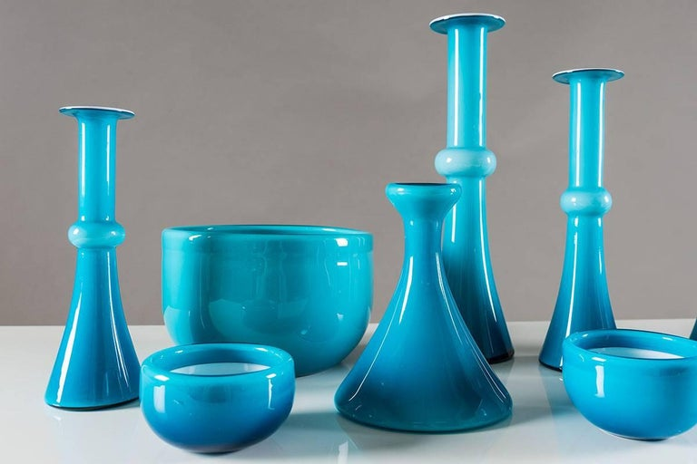 A collection of carefully chosen glass vases and bowls by Per Lutken for Holmegaard, Denmark. The collection consists of six vases up to 32 cm and four bowls. Condition: Excellent.