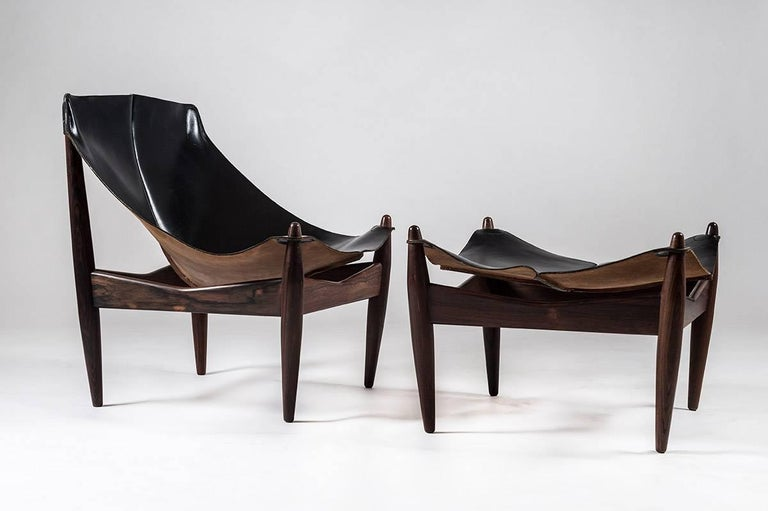 Very rare easy chair and ottoman model 272 in rosewood and leather designed by Illum Wikkelsø. Beautifully designed chair in rosewood and black saddle leather. The solid rosewood legs show a beautiful grain and lean slightly outwords, giving the