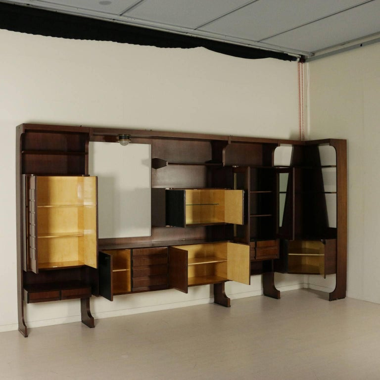 A living room wardrobe with corner. Rosewood veneer, stained ebony panel. Manufactured in Italy, 1960s.