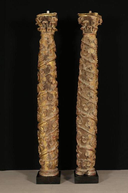 Two th century turned gilt and carved columns with