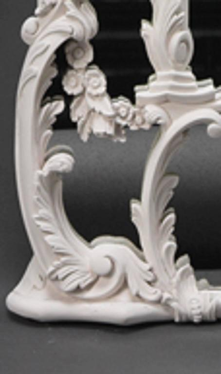 A design attributed to John Linnell. Each arched divided plate within shaped outer slips entwined with foliate branches and leaf scrolls. Each mirror is surmounted by a seated Chinese man and woman holding aloft a foliate parasol. Finished in