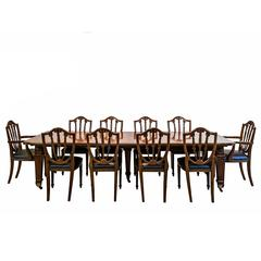 Anglo-Indian or British Colonial Teakwood Extending Dining Table with Ten Chairs