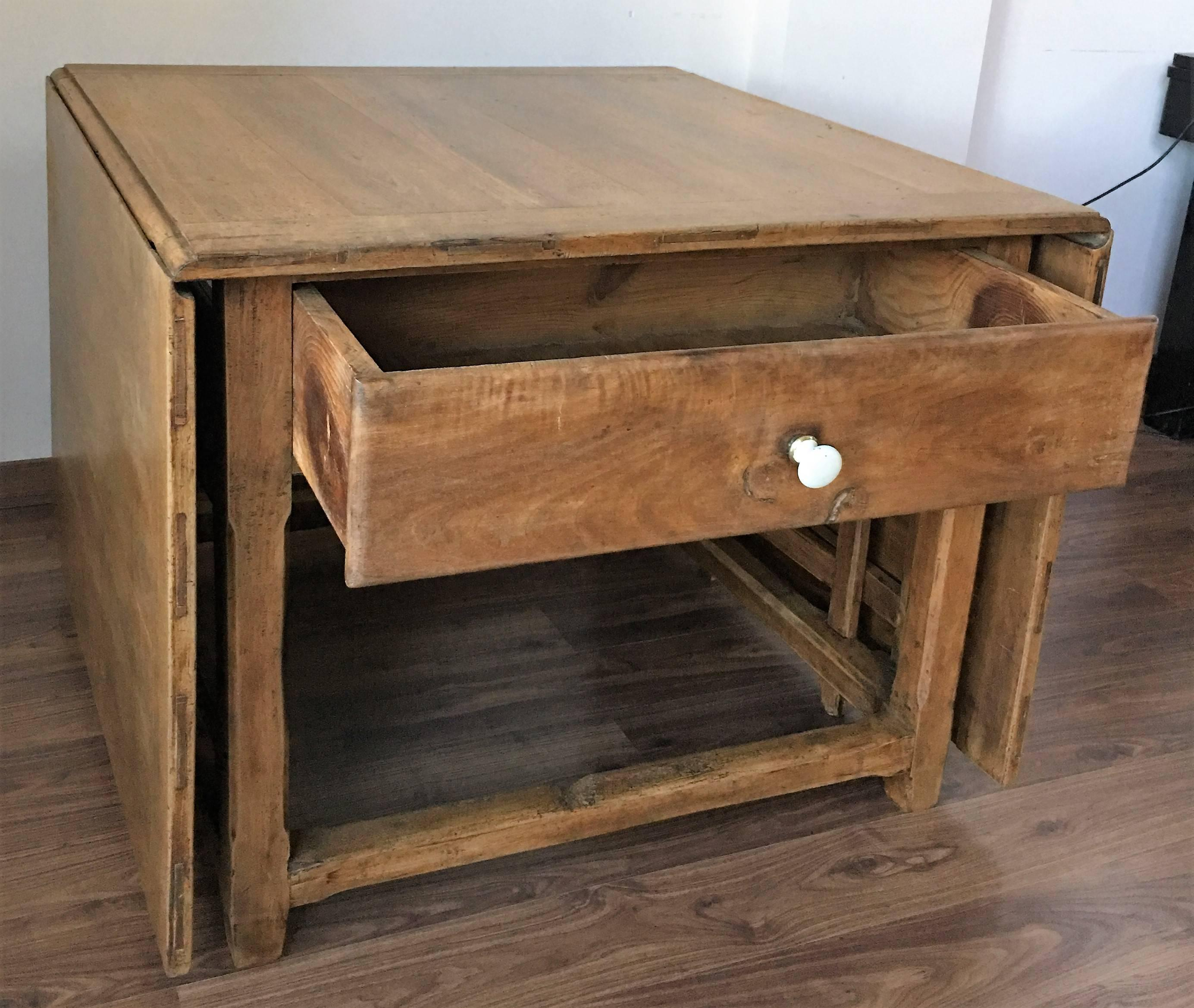 Spanish, 18th Century Drop Leaf Table With Four Gate Leg And Three Drawers