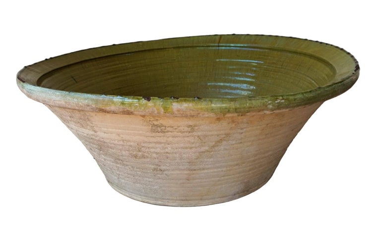 Large one-of-a-kind gorgeous hand thrown and hand glazed green and cream colored stoneware pottery bowl vessel. Thick and glazing like.  This would make an excellent indoor or outdoor water feature. Also appropriate for indoor or outdoor use for