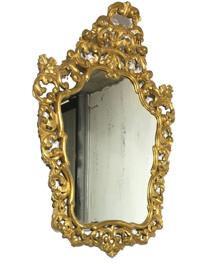 19th French Empire Period Carved Gilt Wood Rectangular Mirror An exceptional matched pair of hand carved and gilded Italian mirrors. Highly carved with flowers , original glass (possibly re-silvered) and original wood backs. Italy, late 19th century.
