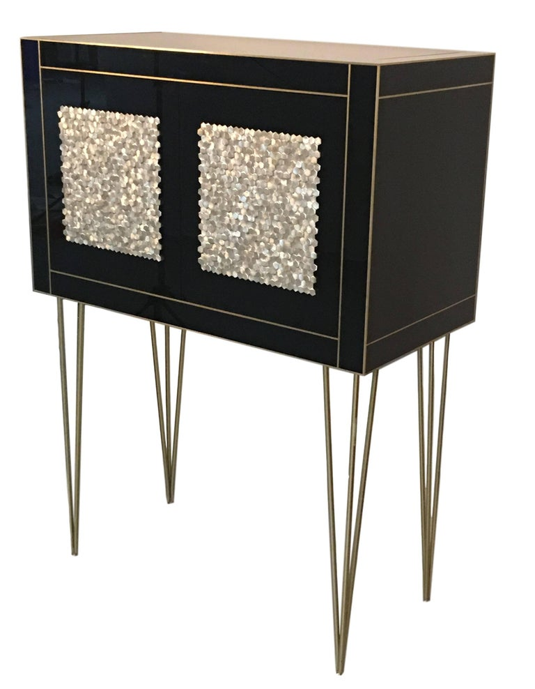 21st century handmade mirrored cabinet on stand in Murano glass and brass inlay with two doors.