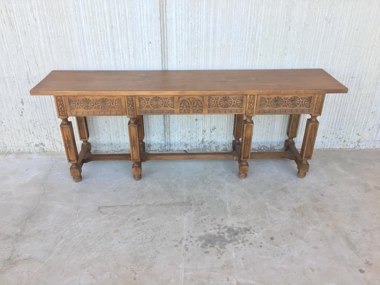 19th century Spanish carved walnut bench or low table with two drawers.
