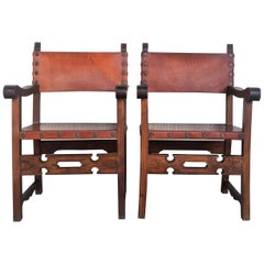Pair of 19th Century Spanish Colonial Style Carved Armchairs with Leather