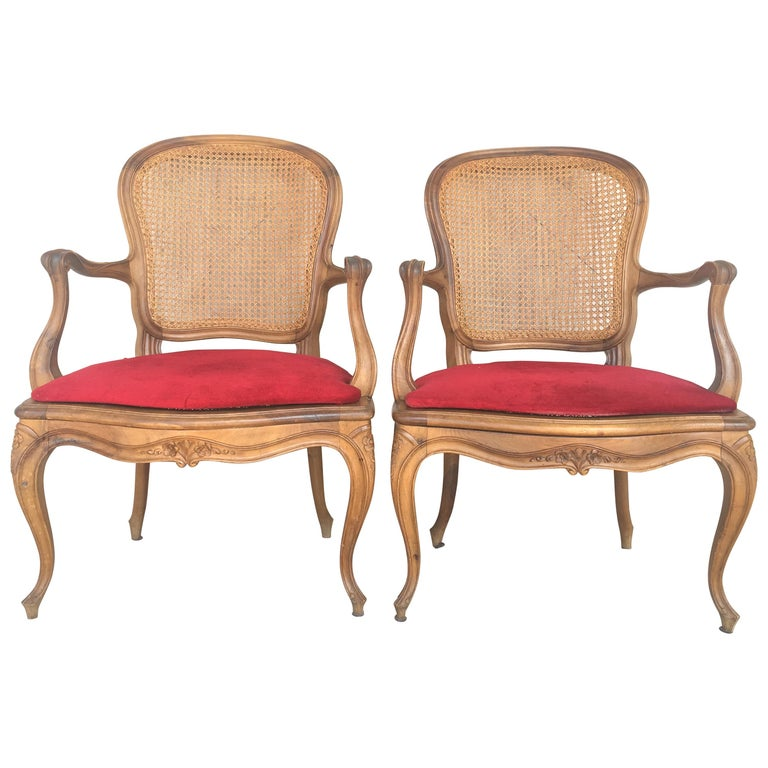 Pair of Louis XV carved Provincial Fauteil's with caned seats and backrests with velvet upholstered rigid cushions-seats, carved crests, rails, arms, and legs. Really beautiful and perfect shape.  ONLY ONE AVAILABLE