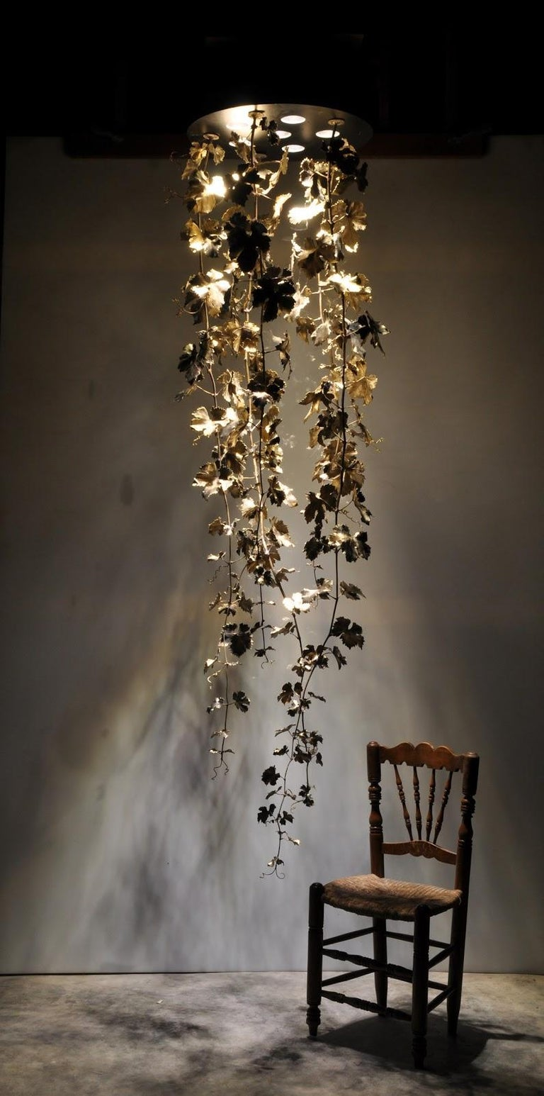 Magnificent chandelier in solid casted brass. Extraordinary elaborate finishes. Rich hangings with handmade leaves. Surface either brass and patinated.