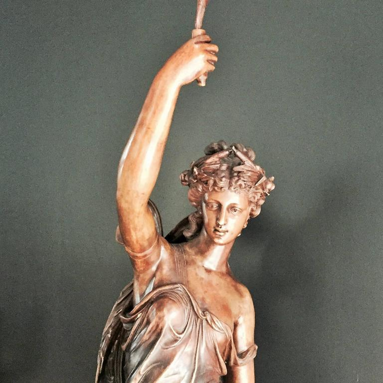 A monumental bronze lady sculpture.