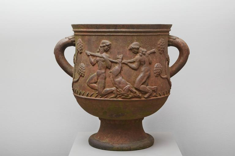 Cast iron urn showing Diana as the Huntress on one side and a hunting scene on the other, designed by sculptor Ivar Johnsson and produced at Na¨fveqvarns Foundry. Swedish work, dated from 1919.