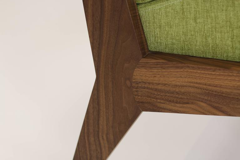Shown in walnut. Available in oak, maple, mahogany and ash Fabrics and leather are COM / COL. Made to order. Lead time 8-12 weeks.
