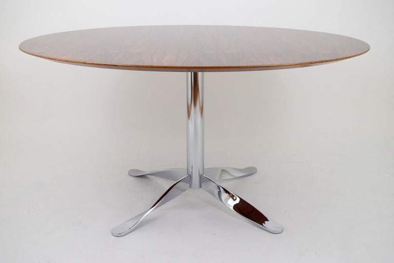 Stunning rosewood dining/conference table with unusual chrome twisted base. Gorgeous expressive grain to rosewood top with beveled edge detail. Supported by a polished chrome four-stared base with twisted legs. Very architectural and high quality