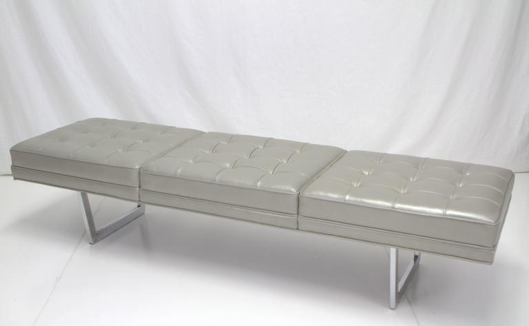 Fascinating metallic silver leather upholstered bench consisting of three biscuit tufted sections on chrome base. Base reminiscent of George Nelson while top upholstered in Florence Knoll style. Newly upholstered with chrome base in original