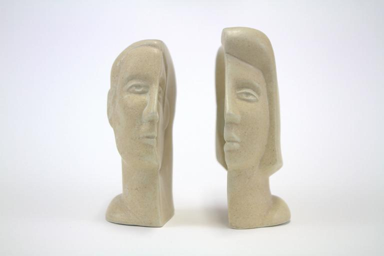 Fascinating interlocking male and female busts by Peter Wright (1919-2003). Slip cast porcelain with mottled glaze, signed
