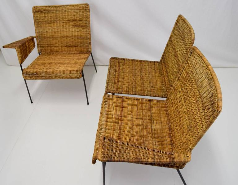 Early modular set by Van Keppel-Green in iron and wicker. Set comprised of two single arm chairs and one armless chair. Multiple configurations possible to create a sofa, or loveset. Shows sign of age with some breaks in wicker and wear to iron
