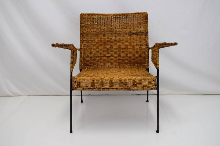 Early iron and wicker lounge chair by Van Keppel-Green. Classic California modernist lines and craftsmanship sets this chair apart. Lovely patina to wicker and iron frame with some breaks and loss to wicker. A three-piece modular set also available.