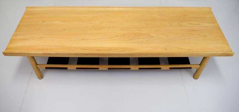 Bleached walnut bench/coffee table by Lawrence Peabody with contrasting dark walnut lower slats. Comprised of solid walnut boards with turned up edges and round legs. Bottom slats serves as extra storage space for optional cushion(can be made upon