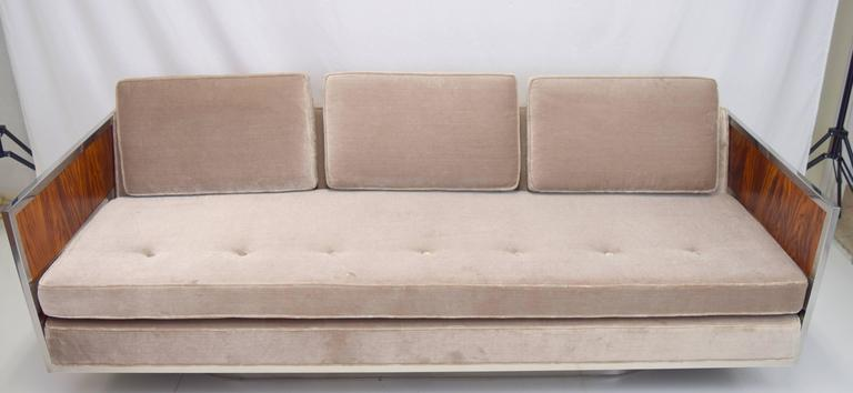 Amazing modernist case sofa attributed to Milo Baughman with rosewood and chrome side panels. Professionally rebuilt and upholstered frame in silver velvet with new cushions and webbing. Sleek oval chrome base and dramatic rosewood grain compliments