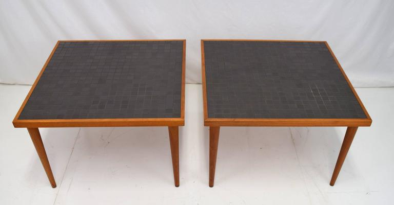 Simple yet elegant pair of Martz tile end tables for Marshall Studios. Walnut frame with tall conical legs and dark charcoal toned tile top. Tiles 1 1/4