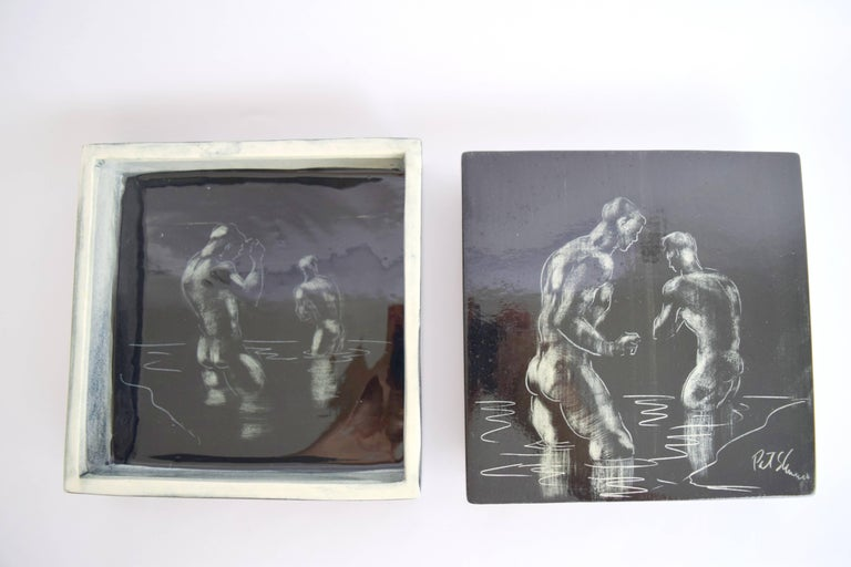 "Rare art pottery box by Pat and Covey Stewart depicting male nudes ""bathing"" in surf. Constructed of hand-formed slab glazed ceramic with hand-painted illustrations to top of lid and inside of box. Lovely black glaze with white line illustrations"