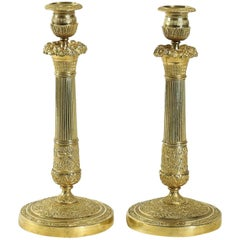 French Empire Period, Pair of Chiseled Ormolu Candlesticks, circa 1805-1810