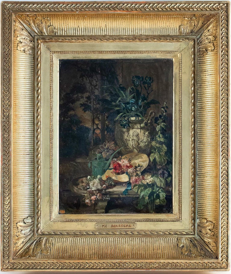 We have the pleasure to introduce, a beautiful, exciting and ornamental oil on panel in its original gilt wood frame, representing a Still-Life The Blue Iris Bouquet, straw hat, and watering can, on a marble ledge.  Our painting is signed on a