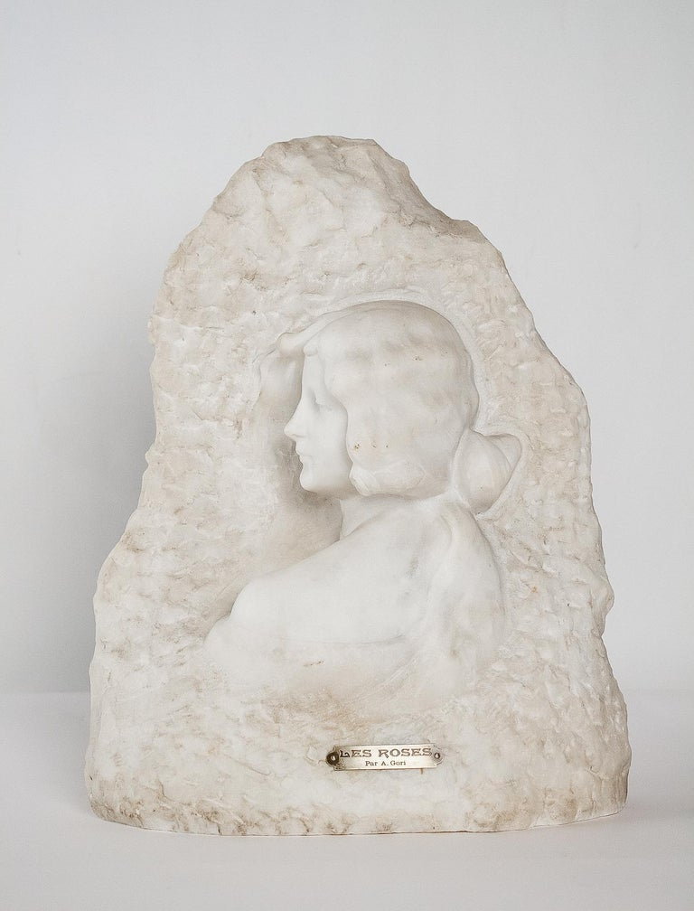 A magnificent and rare white Carrara marble sculpture representing an attractive profile woman with rose in hair. The sculptor voluntarily decided to let the observer think that we model surrounded with a bush of suggested roses.