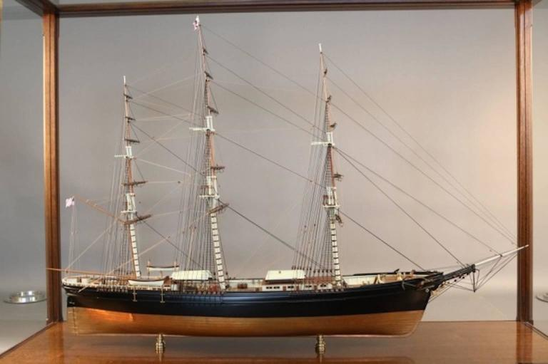 "Highest quality model of the American clipper ship ""Flying Cloud"". Planked deck with expertly executed cabins, hatches, skylights, etc. Hull is copper sheathed below the waterline and painted black above. Intricately rigged with all"
