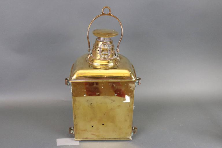 """Ship's masthead lantern by Lovell. With corning fresnel glass lens, vented top, carry handle. Dimensions: 13"""" L x 11"""" W x 21"""" H (without handle)."""