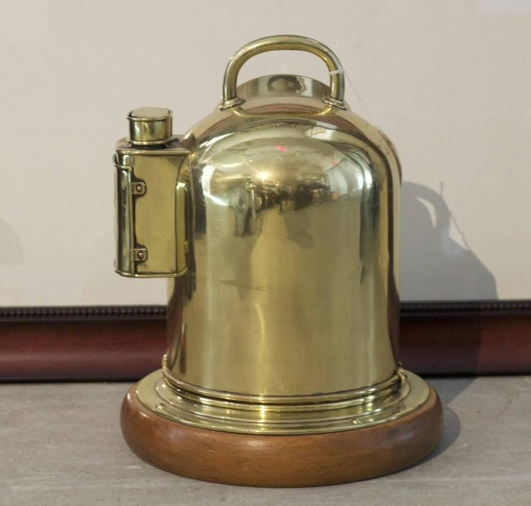 "Antique brass yacht binnacle by Sestrel, mounted to a wood base. Dimensions: 16"" H (with handle) x 12"" diameter."