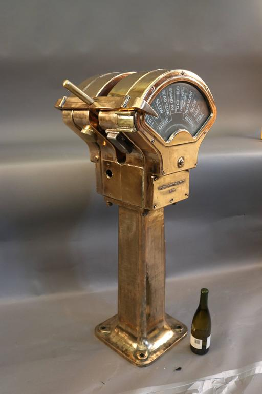 Brass, double-faced engine order telegraph by Siemen Brothers of London. Unique hammerhead design. Shows all commands, does not chime. Overall dimensions: 43
